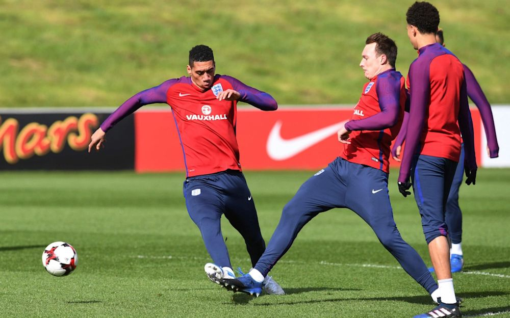 Phil Jones was injured in England training by a Chris Smalling tackle - AFP