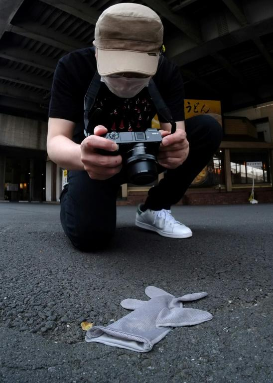 Japanese photographer Koji Ishii's obsession with lost accessories began back in 2004 when he saw a yellow workman's glove dropped near his home and decided to take a photograph with his new flip-phone (AFP Photo/Kazuhiro NOGI)