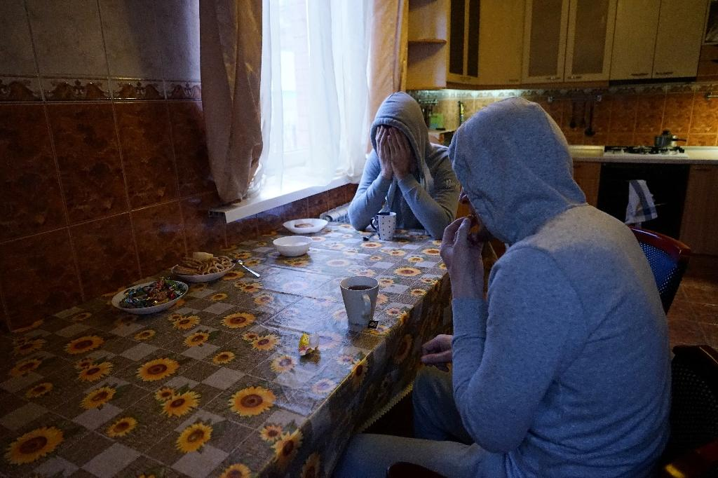 Gay men who fled persecution in Russia's Muslim region of Chechnya due to their sexual-orientation sit in a Moscow apartment on April 17, 2017 (AFP Photo/Naira DAVLASHYAN)