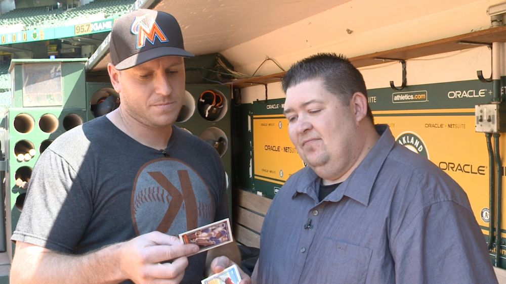 Marlins catcher A.J. Ellis checking out some 1992 Topps. (Yahoo Sports)