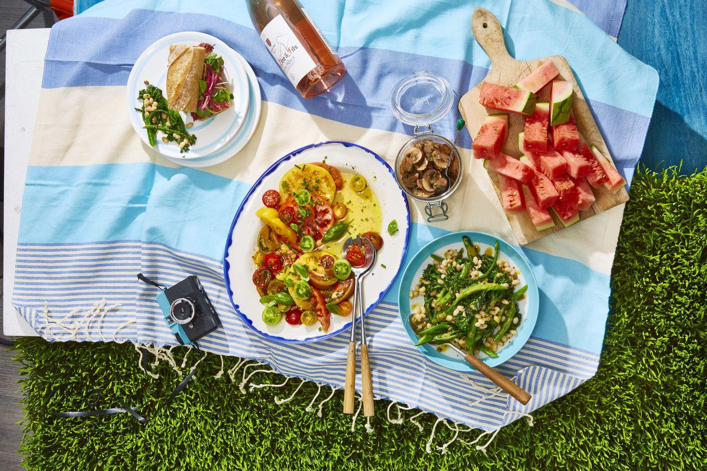 "<p>This simply dressed salad is perfect a perfect summertime side.</p><p><strong><a href=""https://www.countryliving.com/food-drinks/a33217435/heirloom-tomato-salad-recipe/"" rel=""nofollow noopener"" target=""_blank"" data-ylk=""slk:Get the recipe"" class=""link rapid-noclick-resp"">Get the recipe</a>.</strong></p>"