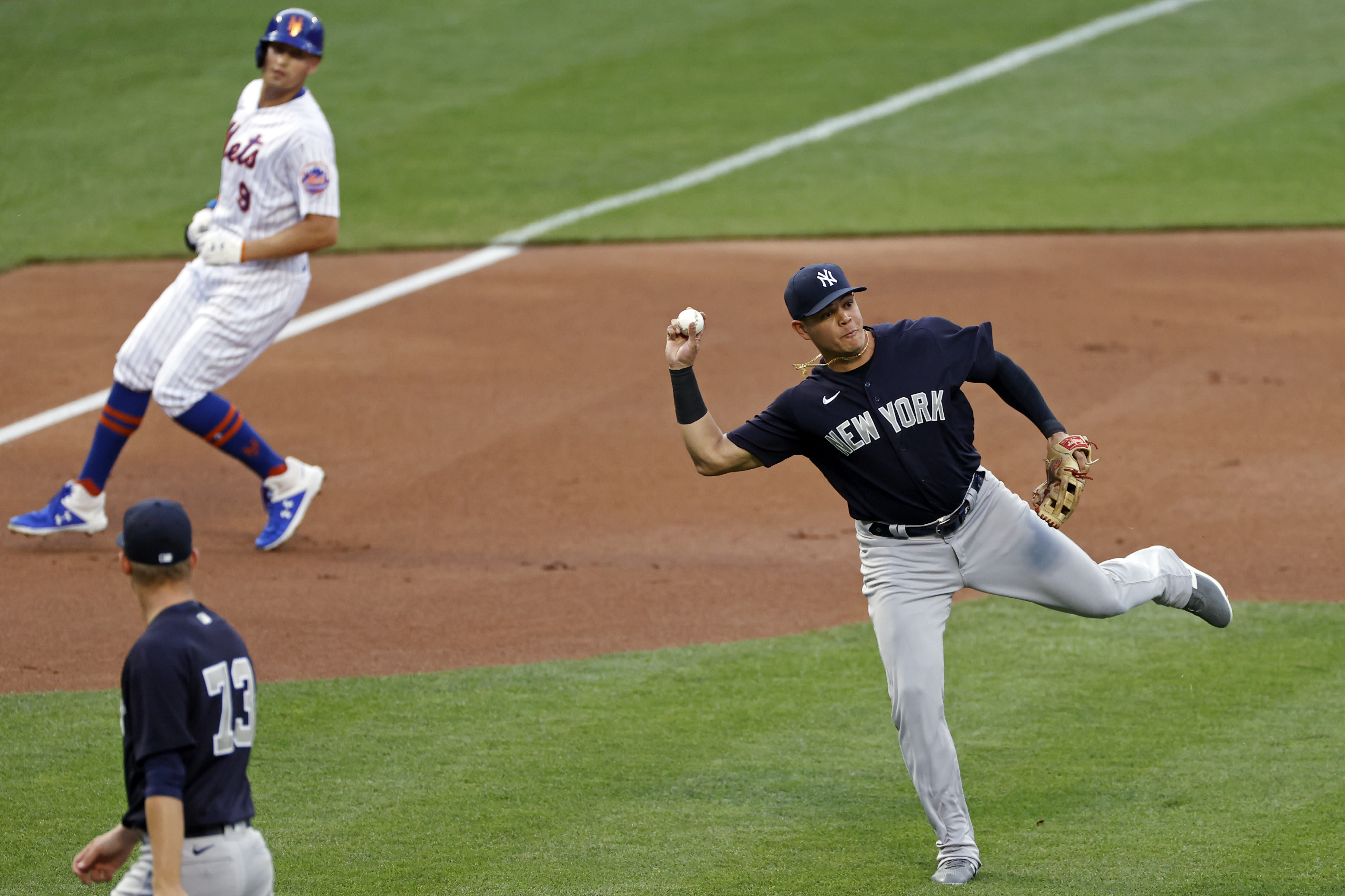 New York Yankees third baseman Gio Urshela throws out New York Mets Yoenis Cespedes to end the first inning of a baseball spring training game Saturday, July 18, 2020, in New York. (AP Photo/Adam Hunger)