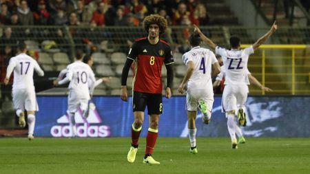 Belgium's Marouane Fellaini looks dejected after Greece's first goal