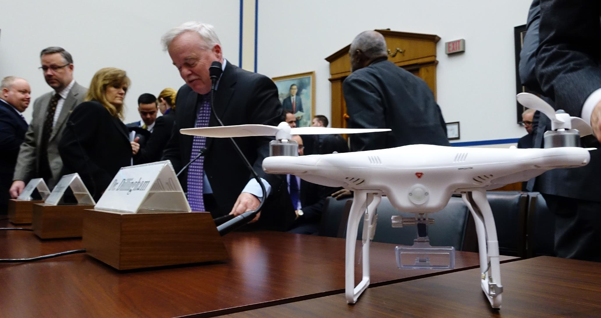 A DJI Phantom 2 drone rests on a table after a hearing on safety issues and the economic potential of civilian drones in Washington DC on December 10, 2014 before a subcomittee of the House Transportation and Infrastructure Committee (AFP Photo/Robert MacPherson)