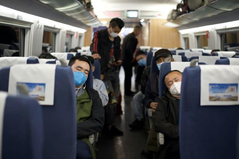 Trains began leaving Hubei on Wednesday (AFP Photo/Noel Celis)