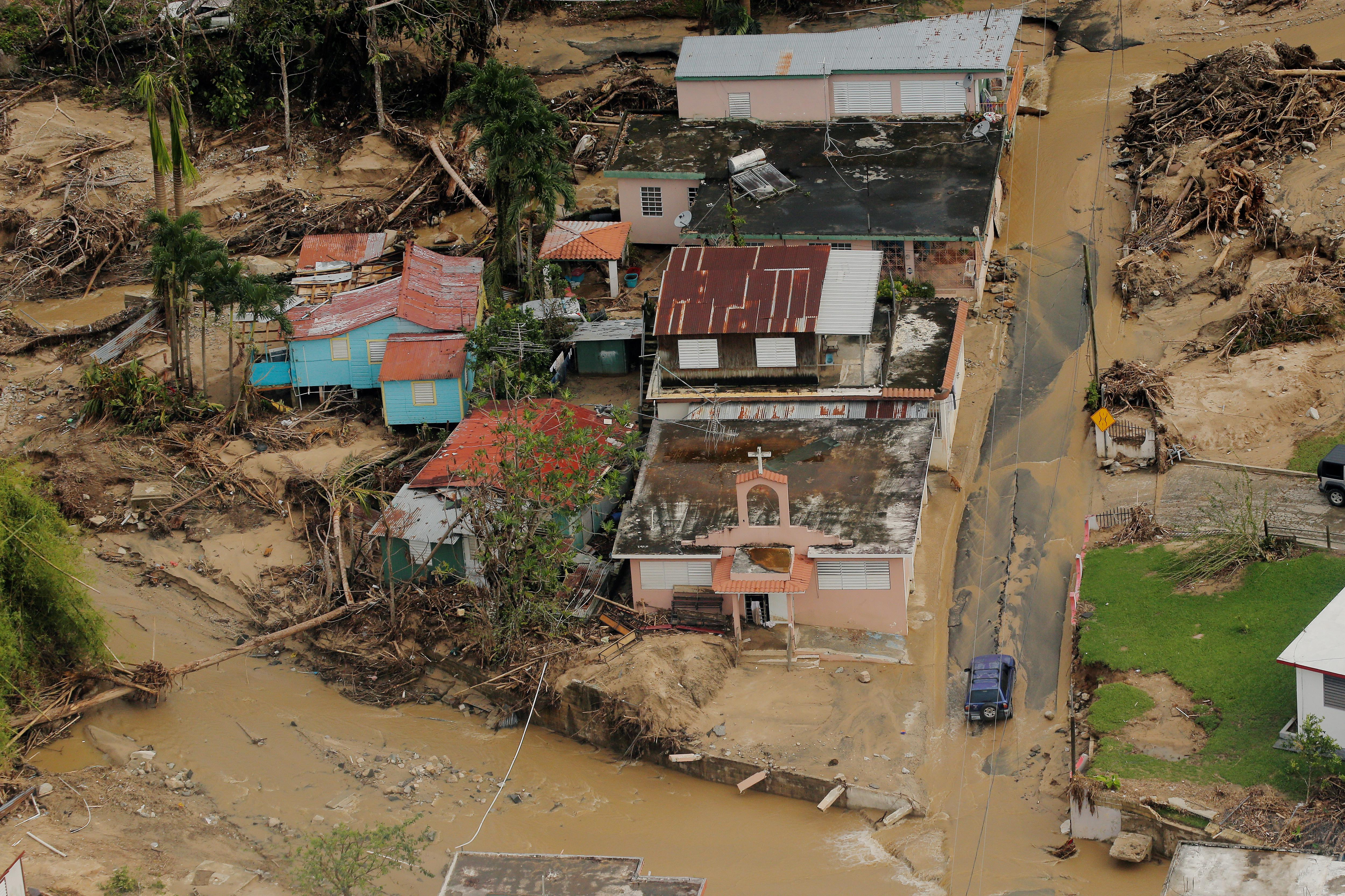 <p>Damage left by a flooded river is seen from the air during recovery efforts following Hurricane Maria near Utuado, Puerto Rico, Oct.10, 2017. (Photo: Lucas Jackson/Reuters) </p>