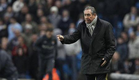Aston Villa's Houllier watches his side from the touchline during their English Premier League soccer match against Manchester City in Manchester