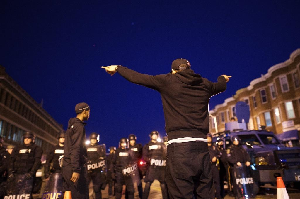 A protester faces off with Baltimore police, on April 28, 2015 (AFP Photo/Mark Makela)