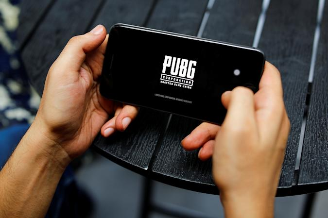 A boy plays Tencent Holdings' PUBG videogame on his mobile phone at a cafe in New Delhi, India, September 3, 2020. REUTERS/Adnan Abidi
