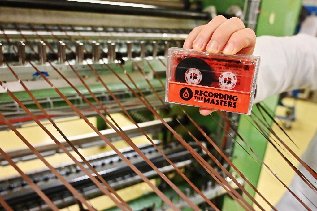 An audio cassette made with magnetic strips in the production plant of Mulann, in Avranches, northwestern France (AFP Photo/CHARLY TRIBALLEAU)