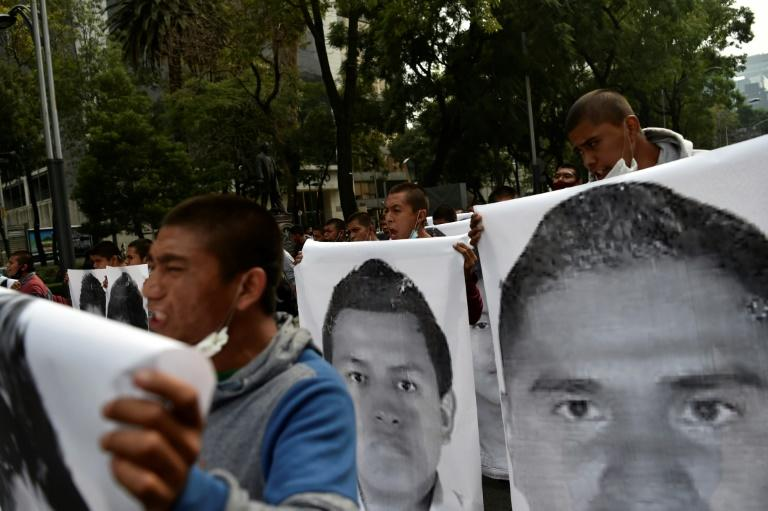 Demonstrators carried large pictures of the 43 students of the teaching training school in Ayotzinapa who went missing on September 26, 2014
