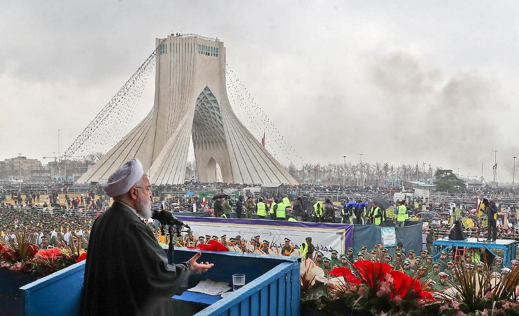 Iranian President Hassan Rouhani addresses crowds during a ceremony celebrating the 40th anniversary of the Islamic revolution on February 11, 2019 (AFP Photo/HO)