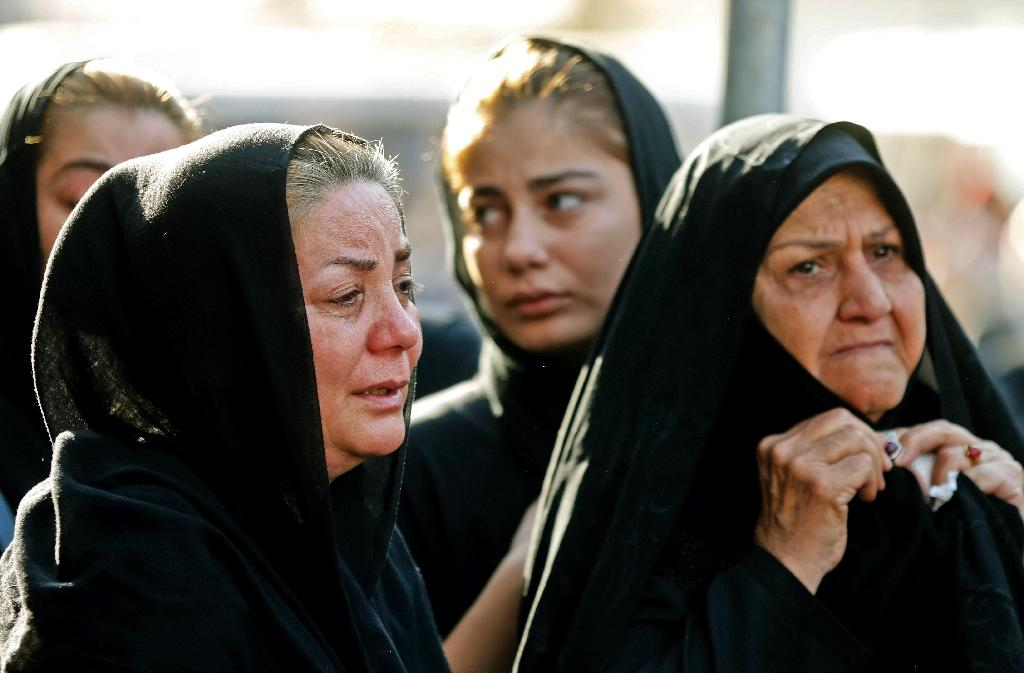 Iranian women mourn during a funeral in the southwestern city of Ahvaz on September 24, 2018, for people killed during a weekend attack on a military parade (AFP Photo/ATTA KENARE)