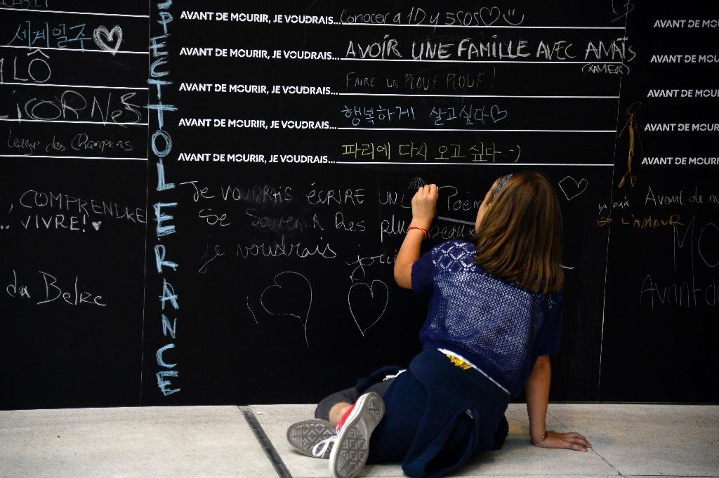 """The collaborative art installation has received a broadly positive reception from the public, but some French media have branded it """"anxiety-inducing"""" or even """"macabre"""" in the context of recent terror attacks in the country (AFP Photo/Bertrand Guay)"""