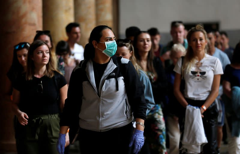 A tourist wearing a mask as a preventive measure against the coronavirus visits the Church of the Nativity in Bethlehem in the Israeli-occupied West Bank