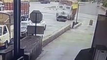 Truck loses control and rams into multiple vehicles at toll booth in southern India