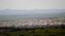 Tens of thousands flee Russia-led attack on Syrian opposition enclave
