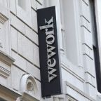 WeWork gets new $1.1 billion commitment from SoftBank, cuts burn rate