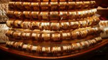 Gold gains 1 pct as investors shelter from sliding equities