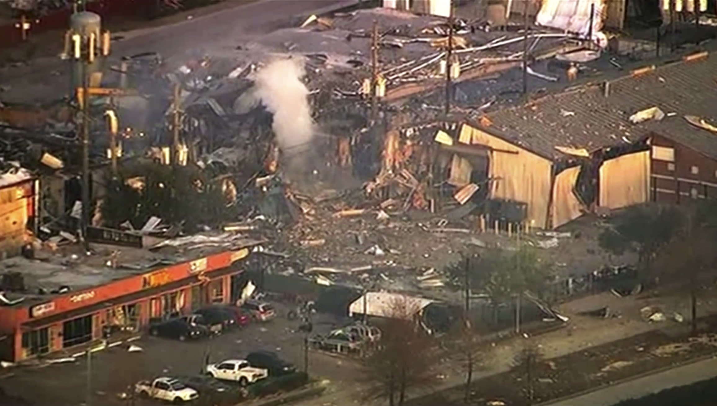This aerial photo taken from video provided by KTRK-TV shows damage to buildings after an explosion in Houston on Friday, Jan. 24, 2020. A large explosion left rubble scattered in the area, damaged nearby homes and was felt for miles away. A fire continues to burn and people have been told to avoid the area. (KTRK-TV via AP)