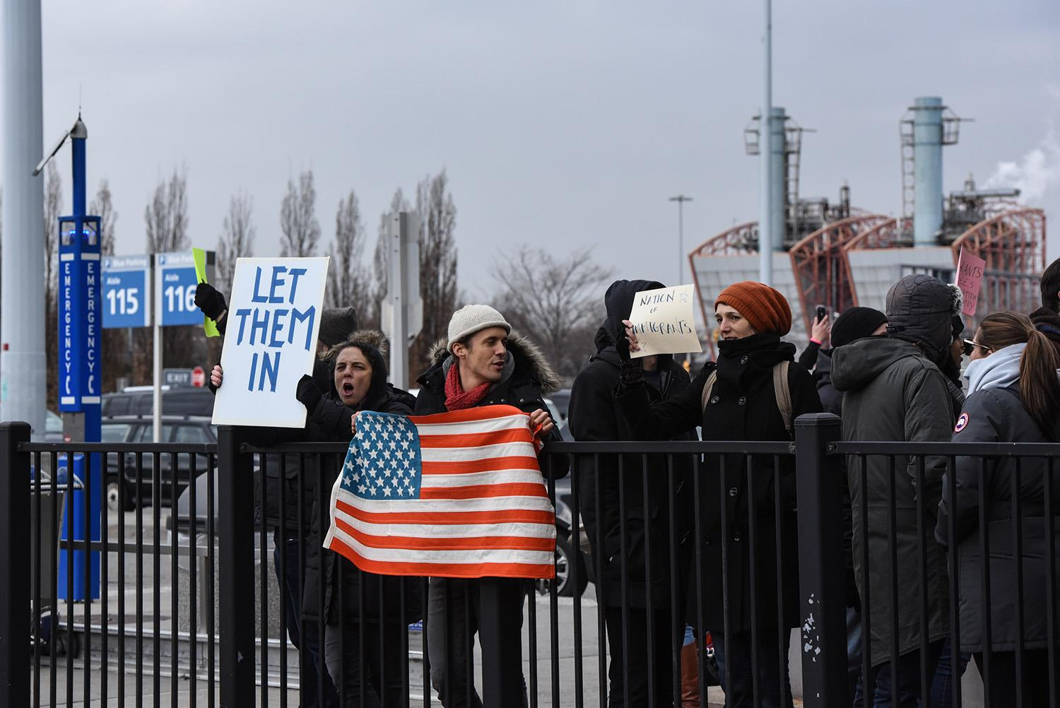 <p>Protestors rally during a protest against the Muslim immigration ban at John F. Kennedy International Airport on January 28, 2017 in New York City. (Photo: Stephanie Keith/Getty Images) </p>