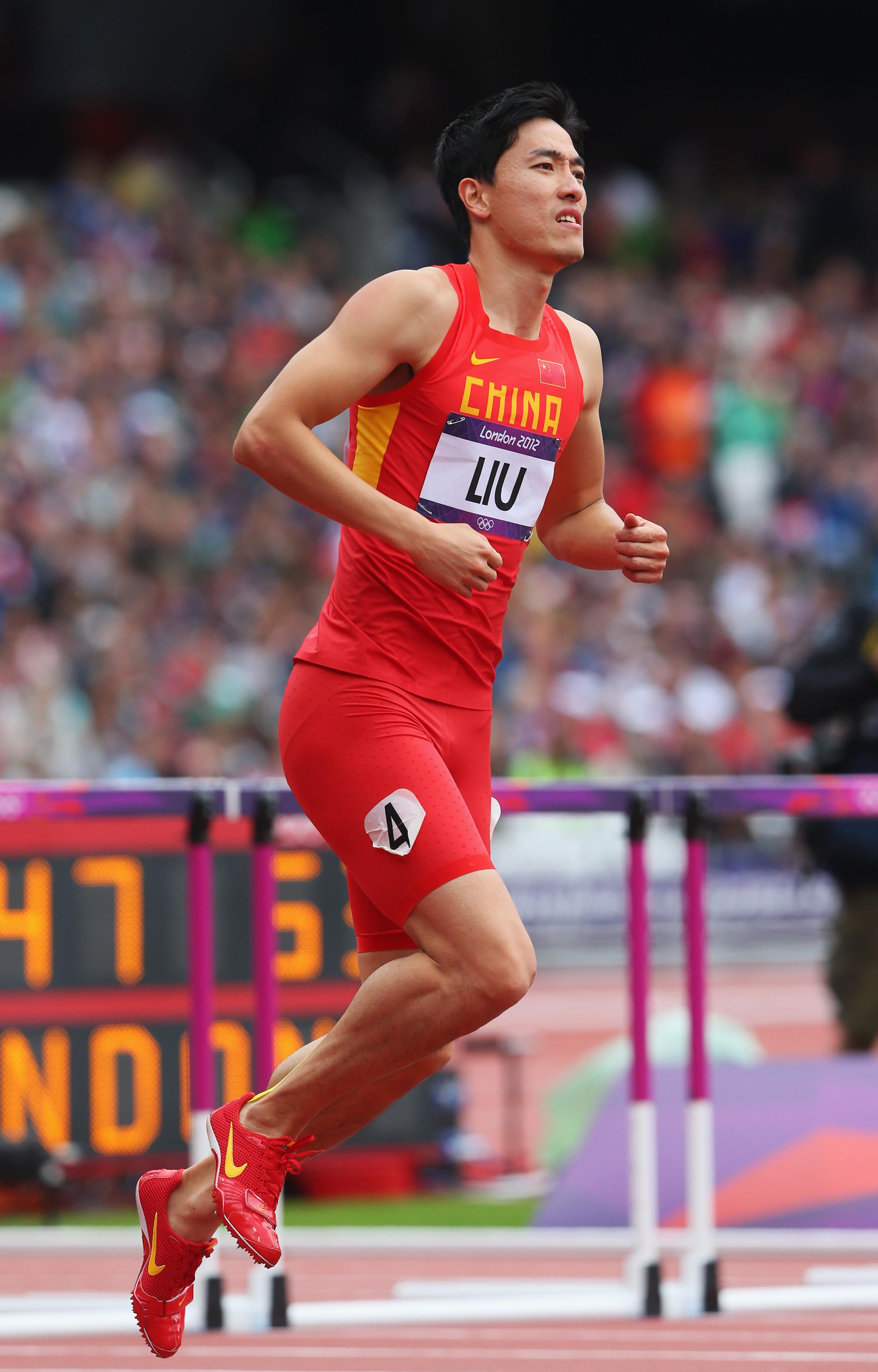 Xiang Liu of China hops on the track after getting injured in the Men's 110m Hurdles Round 1 Heats on Day 11 of the London 2012 Olympic Games at Olympic Stadium on August 7, 2012 in London, England. (Photo by Alexander Hassenstein/Getty Images)