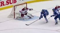 Troy Bodie backhands home the rebound