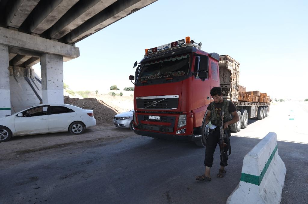 Morek is a key junction for trade between Idlib -- which is held by various rebel and jihadist forces -- and government-controlled Hama (AFP Photo/OMAR HAJ KADOUR)