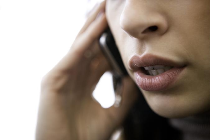 """Talking on cellphone, canon 1Ds mark III"""