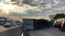 Semi-trailer hauling honey overturns along Indiana highway