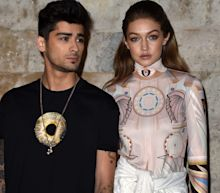Gigi Hadid says she's struggled with her identity while opening up about raising her and Zayn Malik's daughter in a mixed-race household