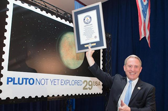 Pluto stamp earns world record for traveling 3 billion miles