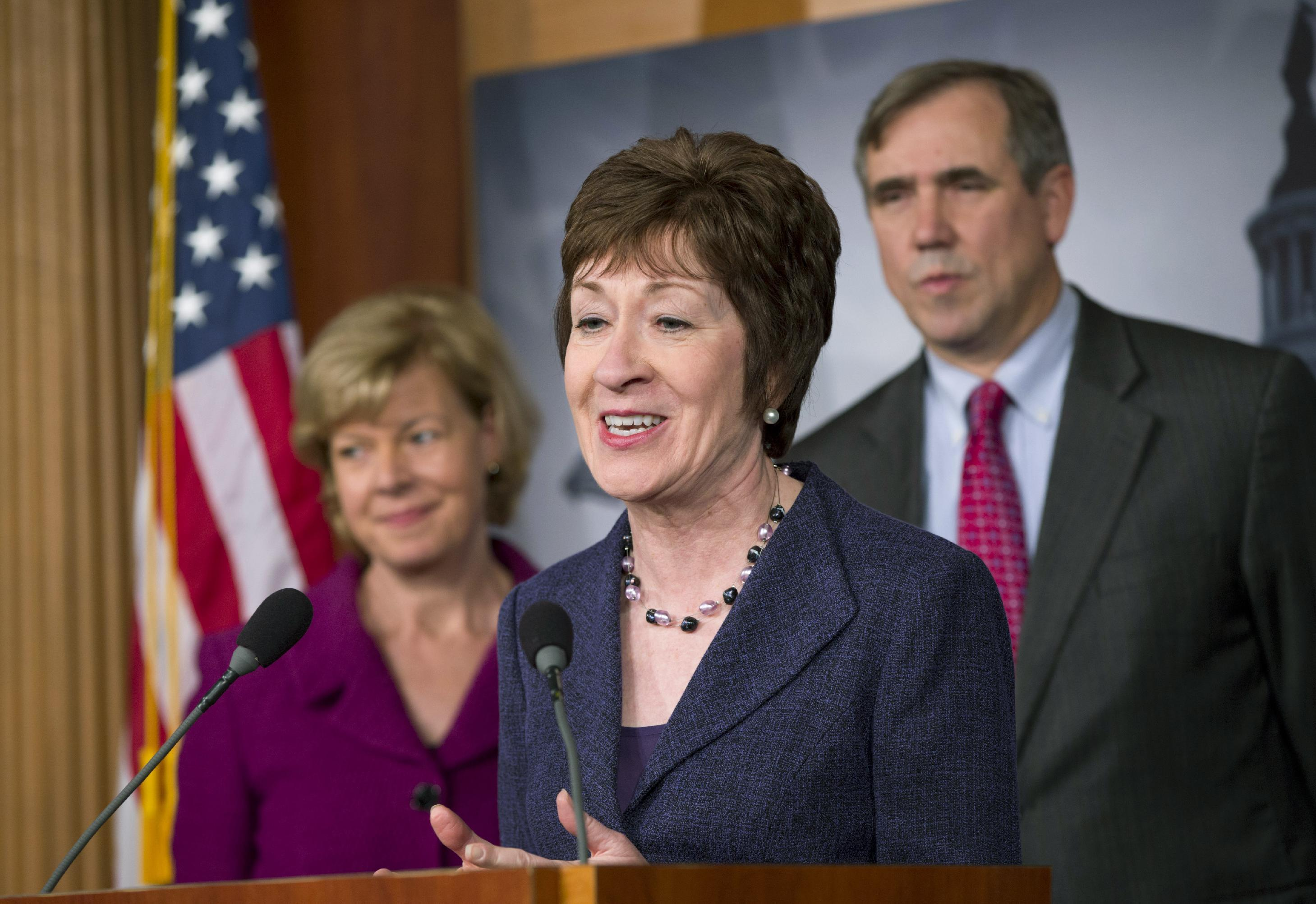 Sen. Susan Collins, R-Maine, flanked by Sen. Tammy Baldwin, D-Wis., left, and Sen. Jeff Merkley, D-Ore., right, talks to reporters after the Senate cleared a major hurdle and agreed to proceed to debate a bill that would prohibit workplace discrimination against gay, bisexual and transgender Americans, at the Capitol in Washington, Monday, Nov. 4, 2013. The bipartisan vote increases the chances that the Senate will pass the bill by week's end, but its prospects in the Republican-led House are dimmer. (AP Photo/J. Scott Applewhite)