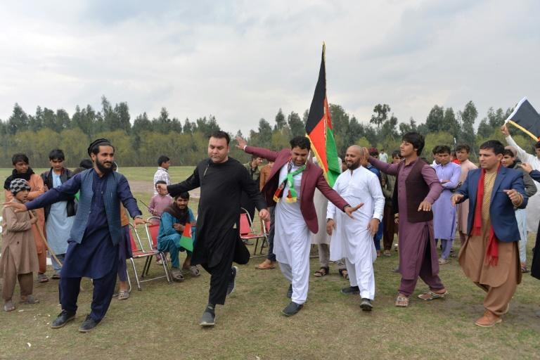 People in the Afghan city of Jalalabad celebrate a week-long reduction in violence