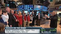 NYSE traders sing traditional 'Wait 'Till the Sun Shines,...