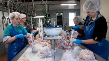 Some U.S. meatpackers announce vaccine plans, but many workers still waiting