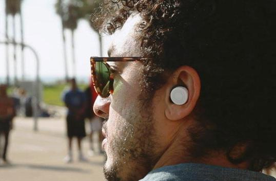 These smart earbuds are volume knobs for the real world