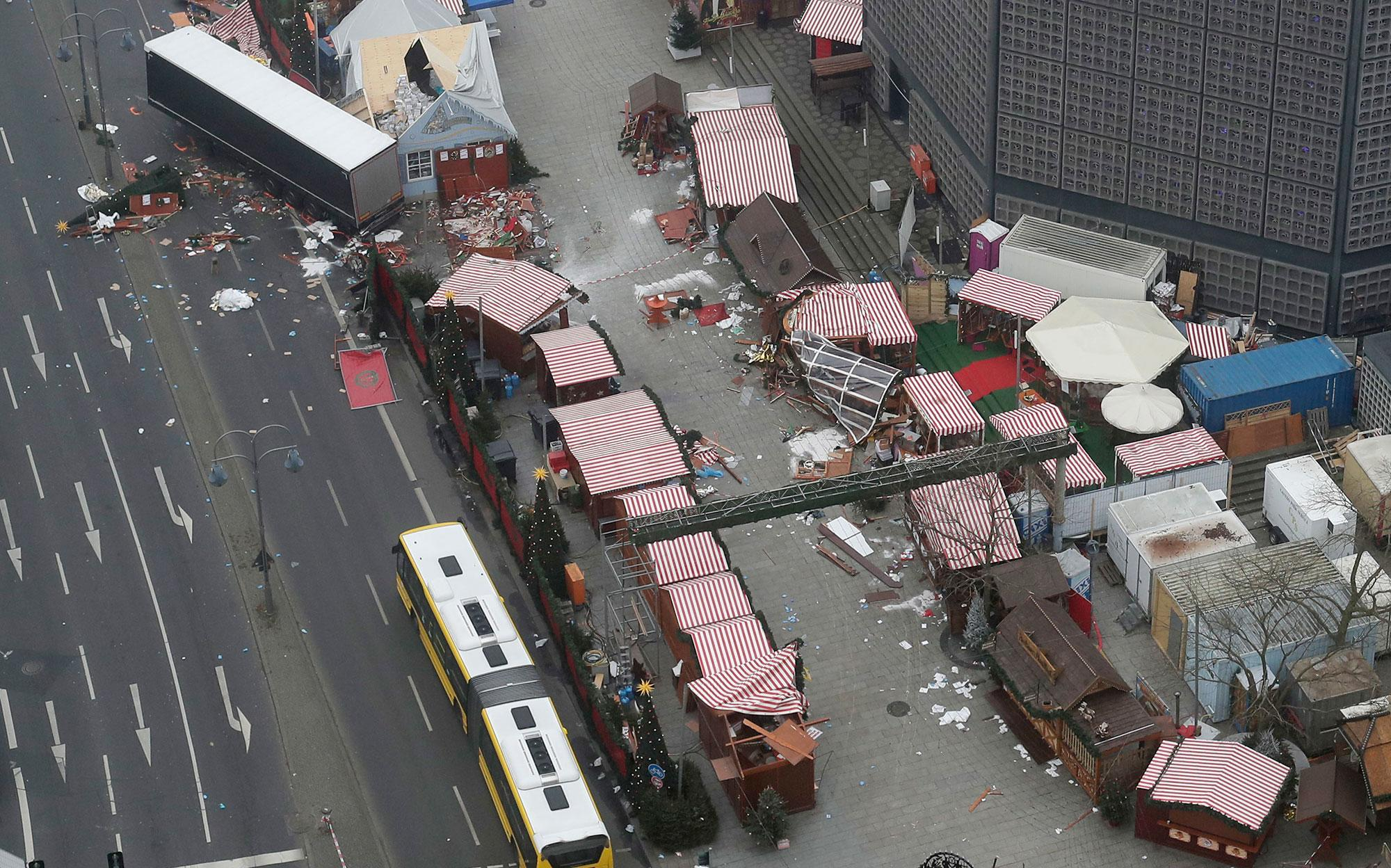 <p>The trailer of a truck stands beside destroyed Christmas market huts in Berlin, Germany, Tuesday, Dec. 20, 2016, the day after a truck ran into a crowded Christmas market and killed several people. (AP Photo/Markus Schreiber) </p>