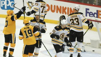 Rust, Johnson help Pens rally past Bruins