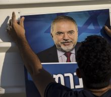 The Latest: Defiant Israel PM seeks to lead ruling coalition