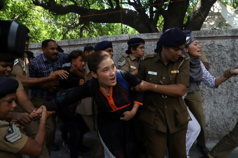 Indian police detain Tibetan students as they protest against the visit of China's President Xi Jinping in Chennai in October 2019 (AFP Photo/STR)