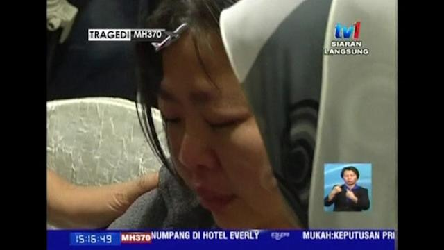 Families of passengers on board missing jet vent anger in protest