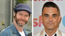 Howard Donald throws serious shade at former Take That bandmate Robbie Williams
