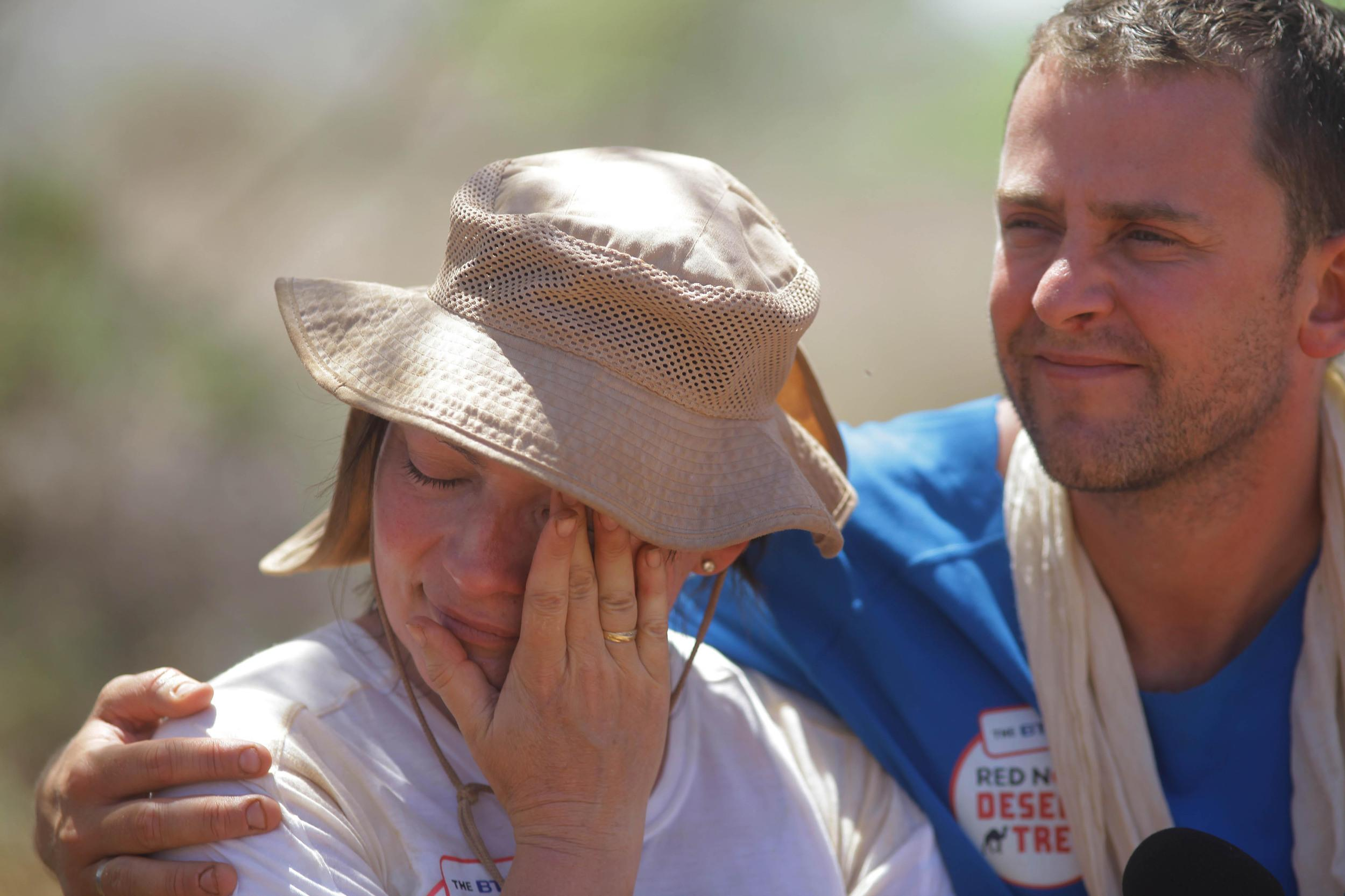 EDITORIAL USE ONLY. TO BE USED ONLY IN CONJUNCTION WITH THE STORY Handout photo issued by Comic Relief of Lorraine Kelly, comforted by Scott Mills as she cries after hearing a message from home live on Radio 1 on the last morning of the trek on day 5 of the BT Red Nose Desert Trek for Comic Relief in the Kaisut desert, Kenya.