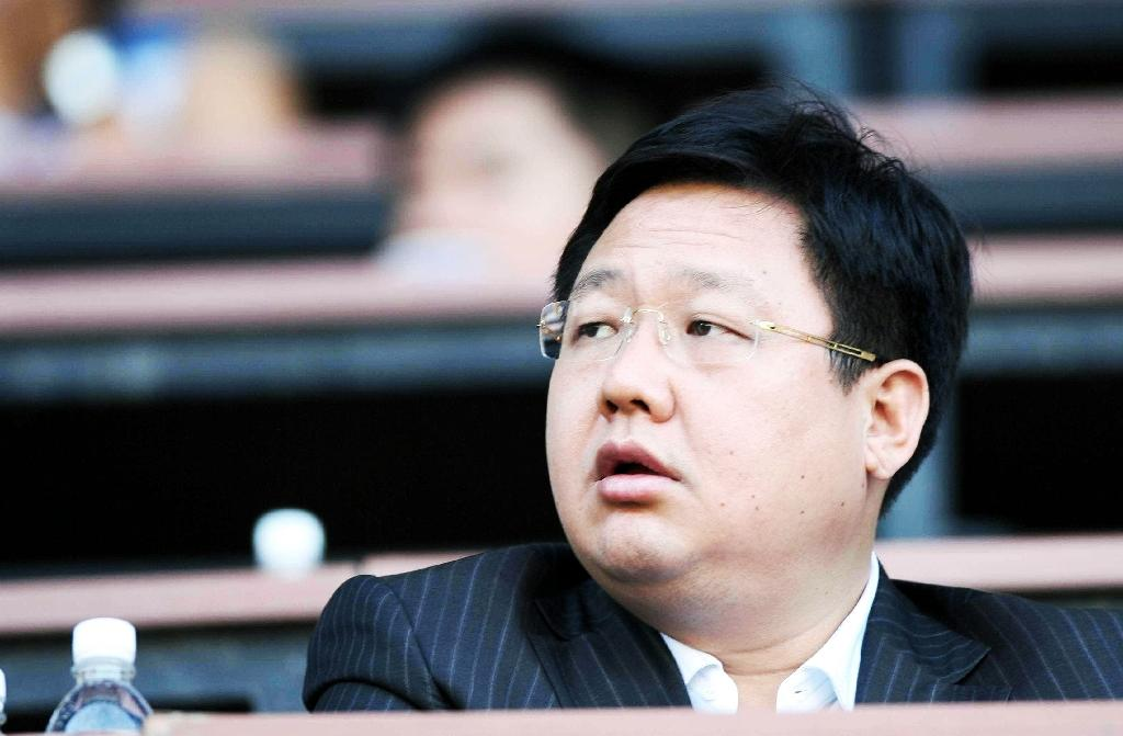 Chinese billionaire Xu Ming died in prison at the end of 2015 (AFP Photo/-)
