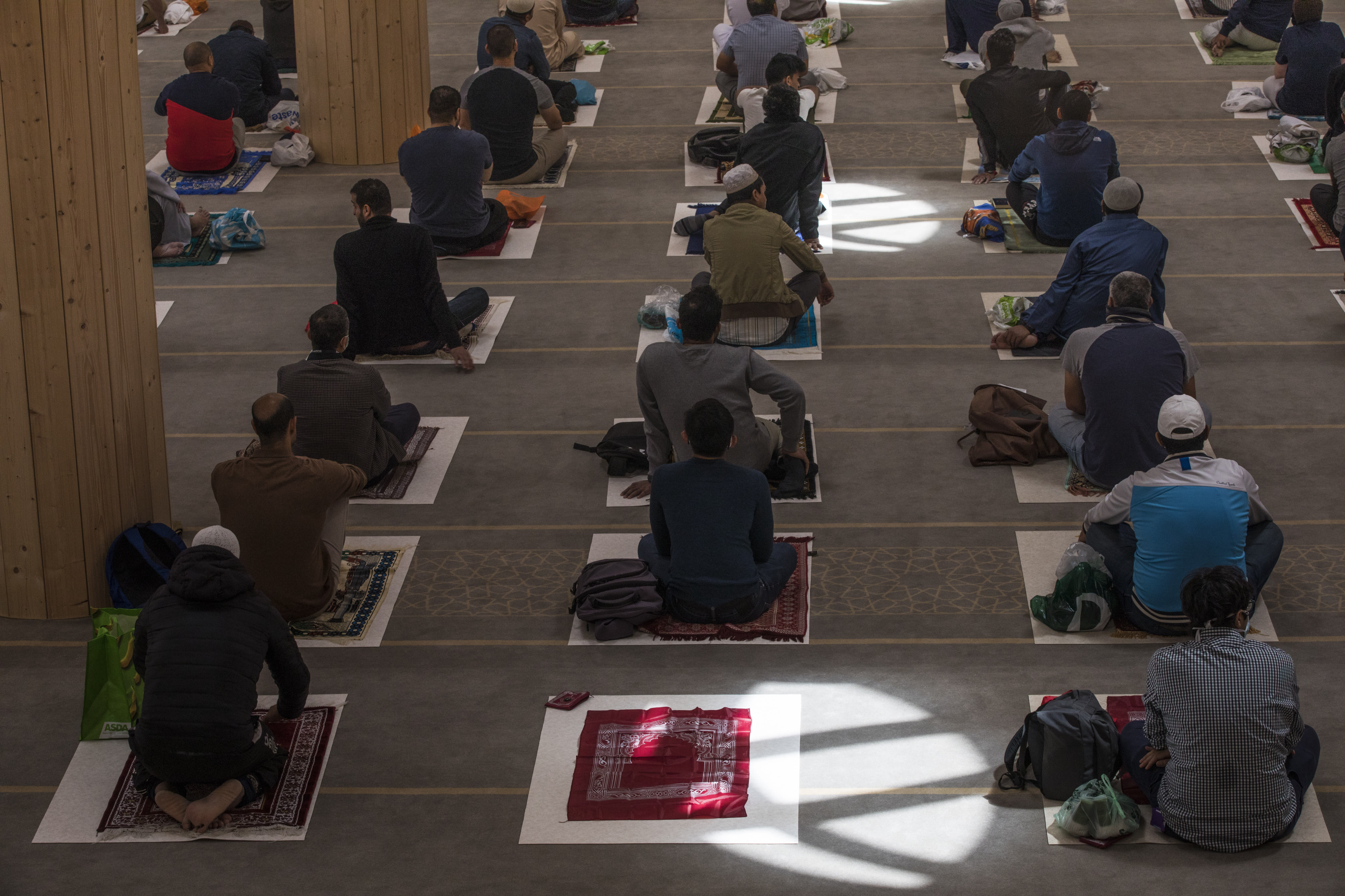 Worshippers at the Cambridge Central Mosque in Cambridge, England, attend the first Friday communal prayers since lockdown on Friday, July 10, 2020. Mats are now spaced apart during communal prayers, and worshippers are asked to bring their own. Attendees' names and phone numbers were collected for possible contact tracing purposes. (AP Photo/Elizabeth Dalziel)