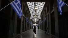 Greece exits $330B bailout as Venezuela devalues currency by 96%