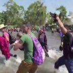 Central American migrants cross river into Mexico