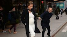 Chrissy Teigen Sets the Record Straight About That Photo With the Random Stranger