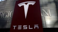 Tesla apologies after customer protested at autoshow, says to share car data with Chinese regulator